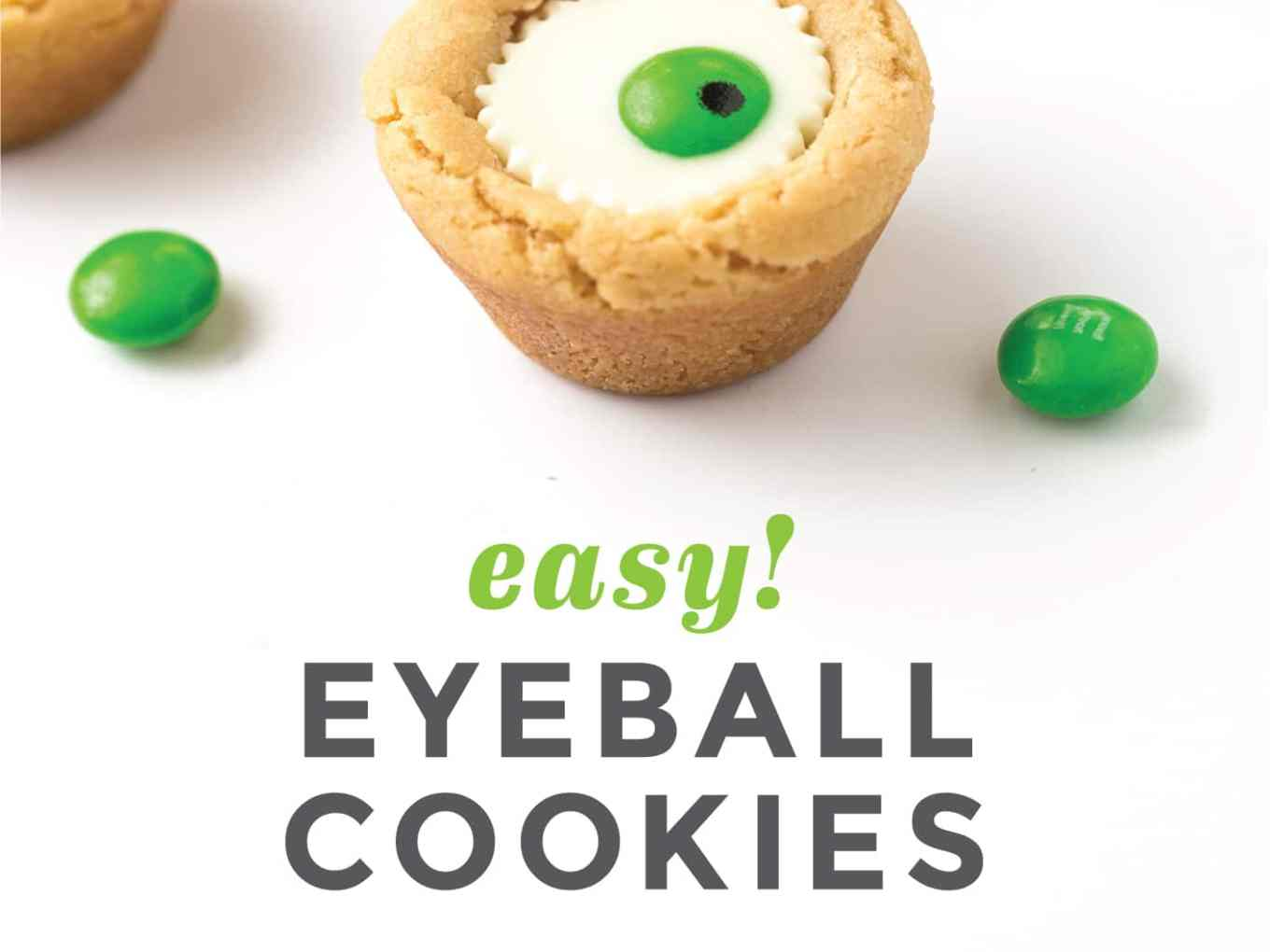 Mini white peanut butter cup cookies with green M&M in center to look like Halloween eyeball.