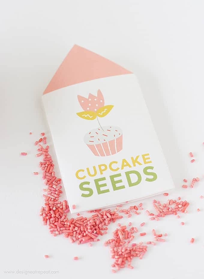 """Learn """"How to Grow A Cupcake"""" with these free springtime printables by Design Eat Repeat! Includes the instructions on how to create these """"Cupcake Seed"""" packets, that include a tulip topper & sprinkles! Great for a party activity or party favor!"""