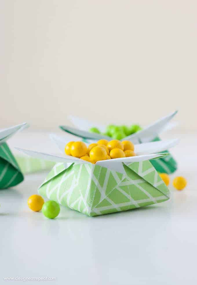 "Looking for a quick St. Patrick's Day craft? Print off this FREE paper & follow the tutorial to make a origami ""Pot of Gold"" box. Fill with candy for a fast & fun project you can make at home!"
