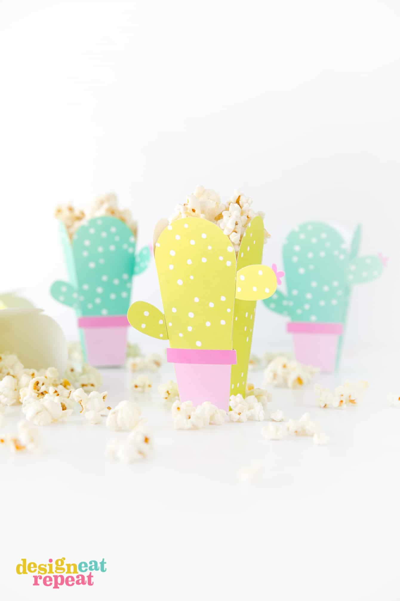 Can these be any cuter?! Cactus popcorn boxes! Get the free popcorn box template at DesignEatRepeat.com   #printable #popcornbox