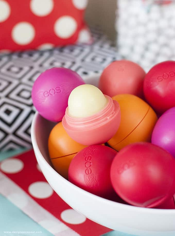Send your guests away in color with these Holiday Party Favors using EOS Lip Balm!