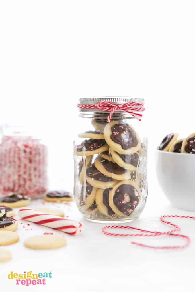 Jar of peppermint cookie wafers with red twine wrapped around the lid.