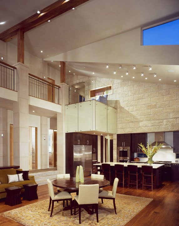 contemporary dining and kitchen with vaulted ceilings
