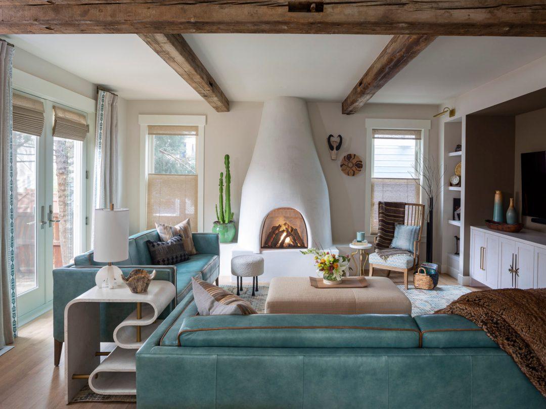 Julee, familyroom. blue sofa, fireplace