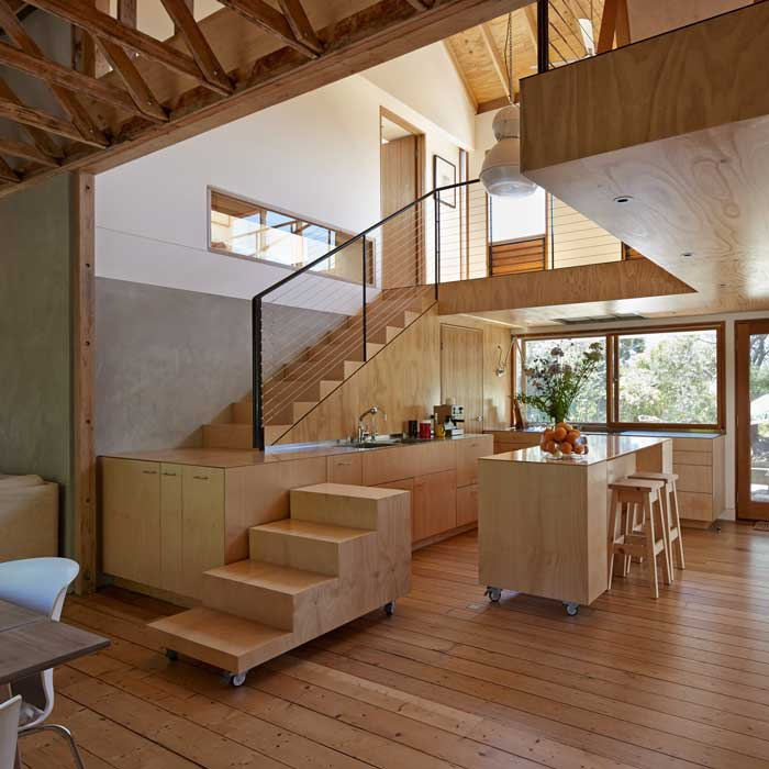 The design questions functions. Here, the kitchen bench transforms into a staircase.