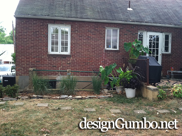 grasses and azaleas planted infront of basement