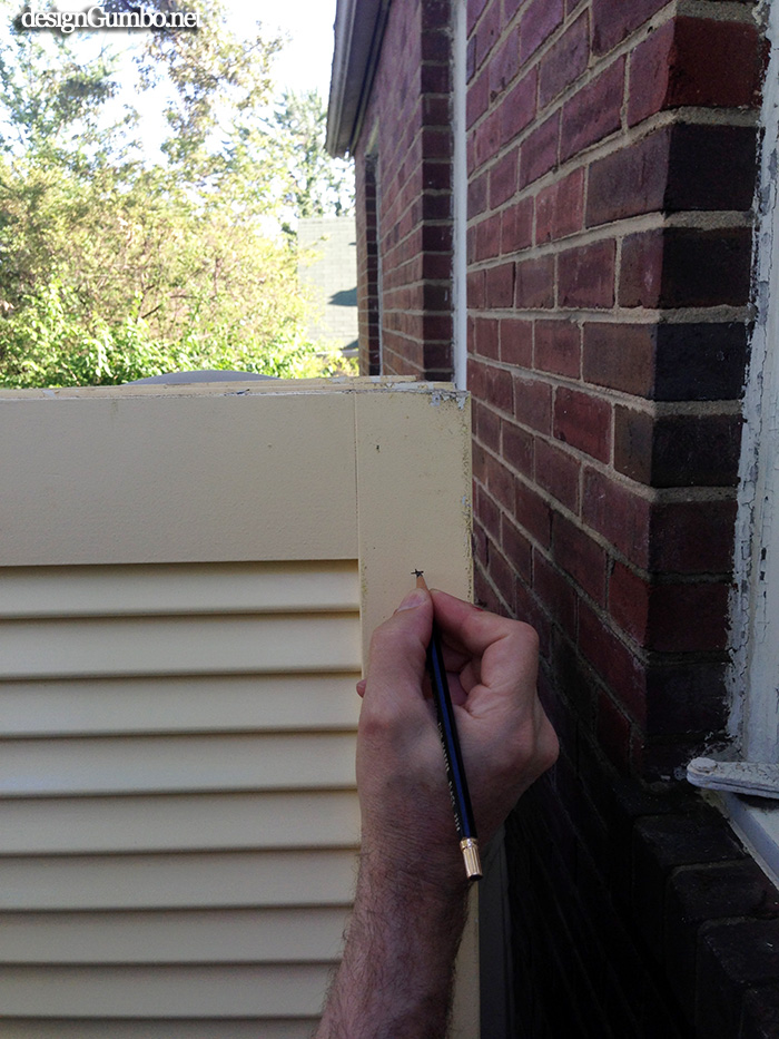 Marking the shutters for the drill holes