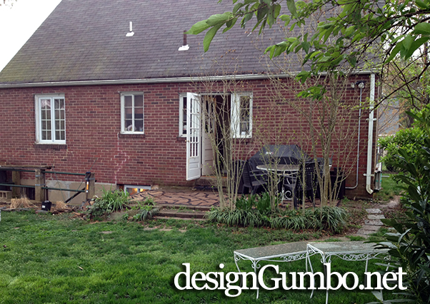 spring green grass, old patio, no retaining wall