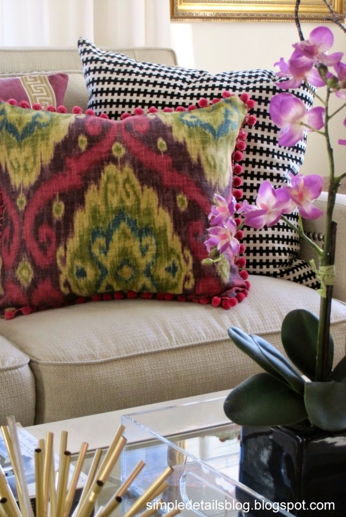 Raspberry Ikat pillow with pom pom fringe