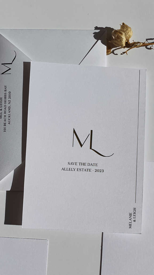 Modern semi-custom wedding invitation suite with elegant monogram featuring couples initials M+L and a minimalist design in gold foil on white cardstock