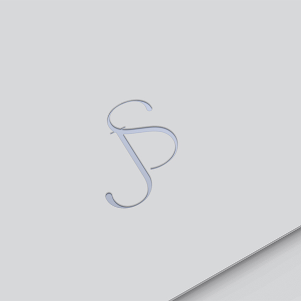 close up of letterpress wedding logo with initials J and S on thick luxury card