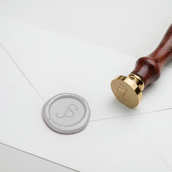 Wedding wax seal with monogram featuring the bride and grooms initials J and S