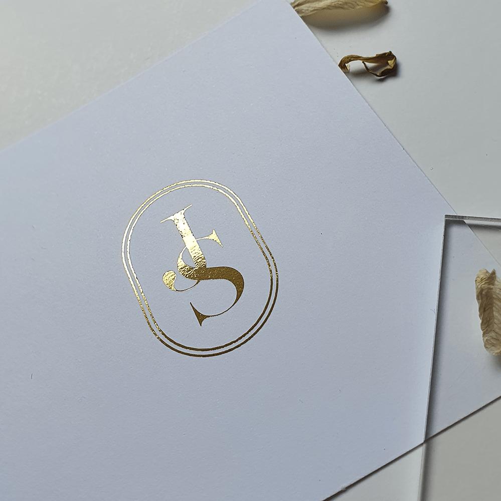 custom wedding invitation design and monogram in gold foil with initials J+S