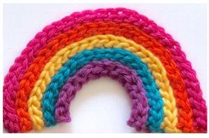 A smoothly curving slip stitch rib rainbow thanks to invisible increases!