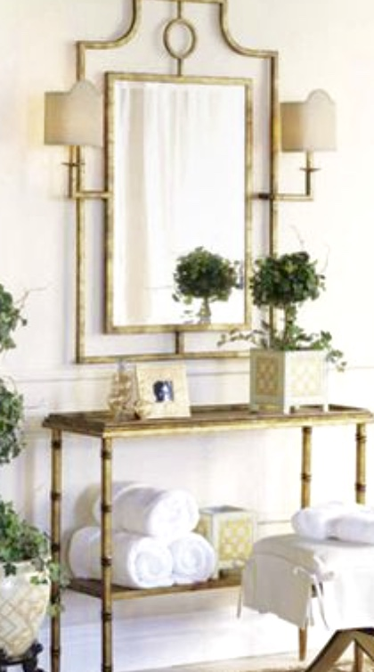 a side table with a framed mirror
