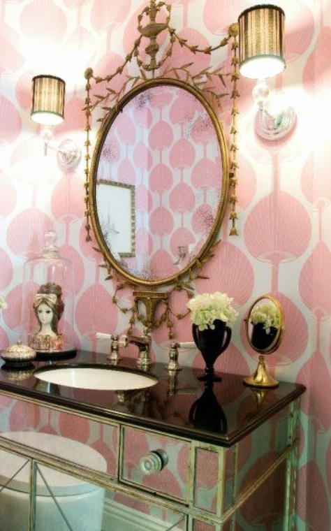 A mirror with a mirrored chest below it.