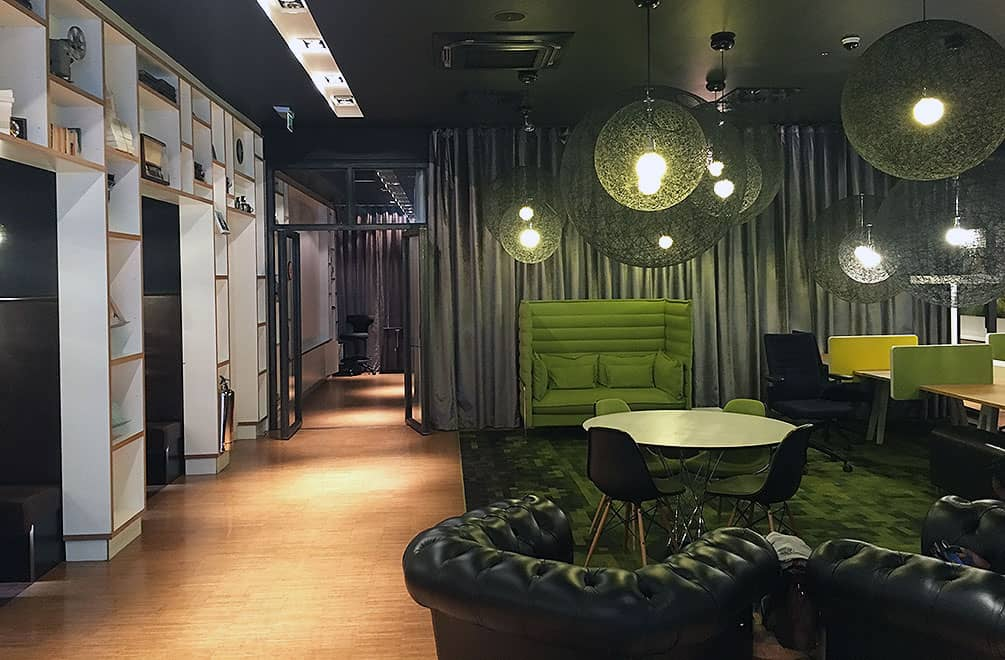 Green section of CitizenM lobby