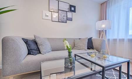 floor lamp beside sofa and window