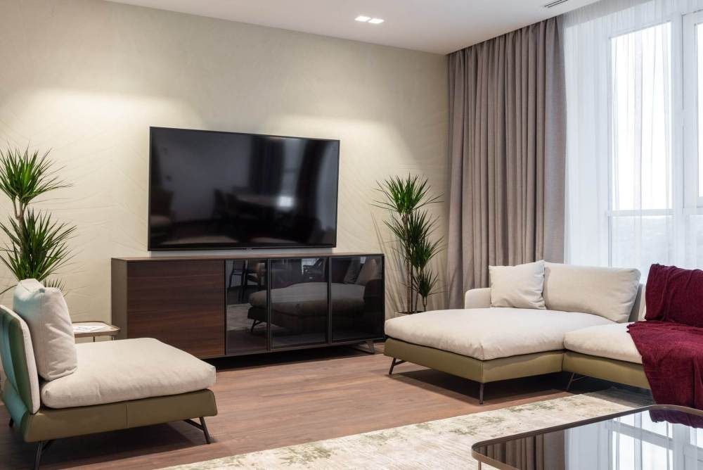 living room with furniture and tv set