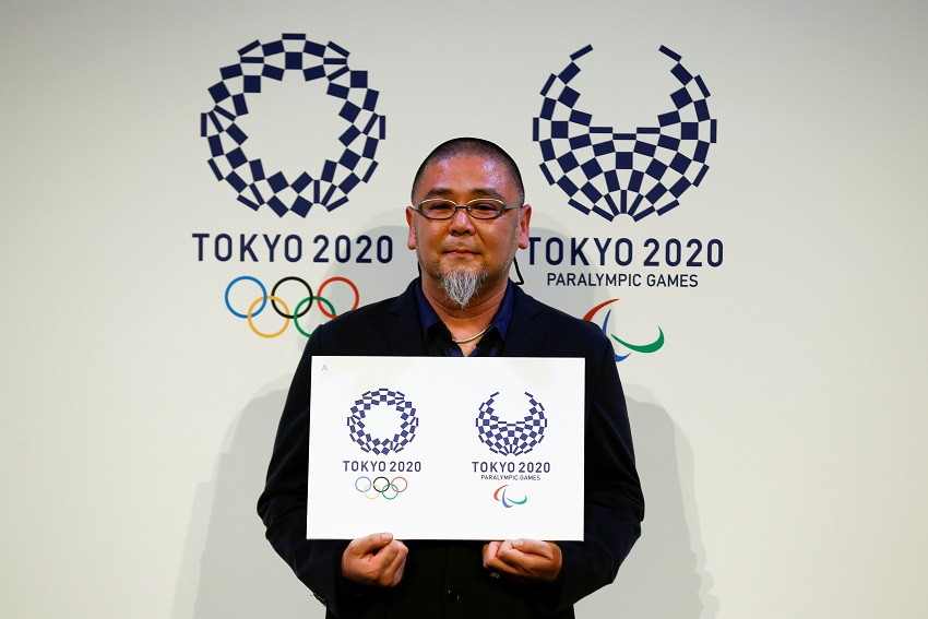 Artist Asao Tokolo poses with his winning designs for the Tokyo 2020 Olympic Games and Paralympic Games after their unveiling in Tokyo, Japan April 25, 2016. REUTERS/Thomas Peter