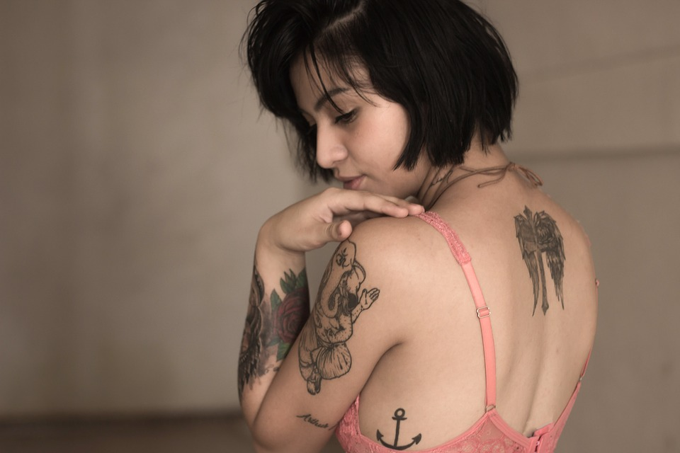 woman with back and arm tattoos