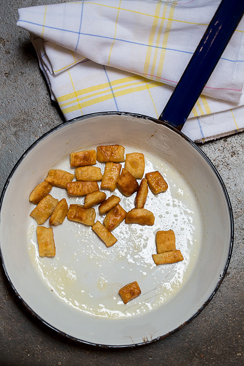 bits of dough are fried in butter to create 'croutons' which are added to the noodle and lentil soup