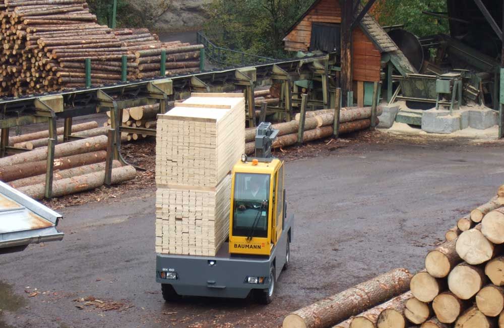 Baumann Sideloader carrying large stacks of cut lumber