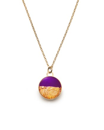 Gold necklace featuring a purple foil layered with gold leaf, set in resin. Handmade.