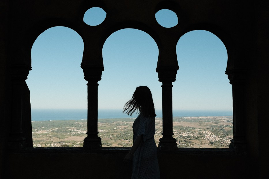 silhouette of a woman in front of a viewpoint at Pena Palace in sintra portugal
