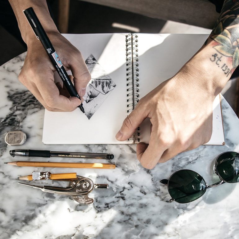 artist-fellowship-at-desk