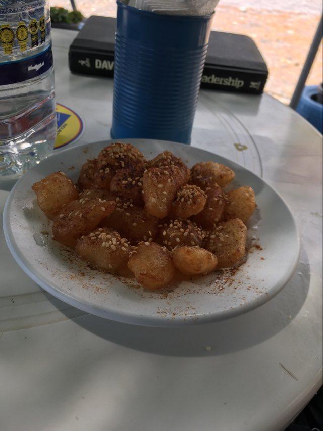 Loukoumades- Traditional Cretan pastry- Deep fried dough with honey and sesame