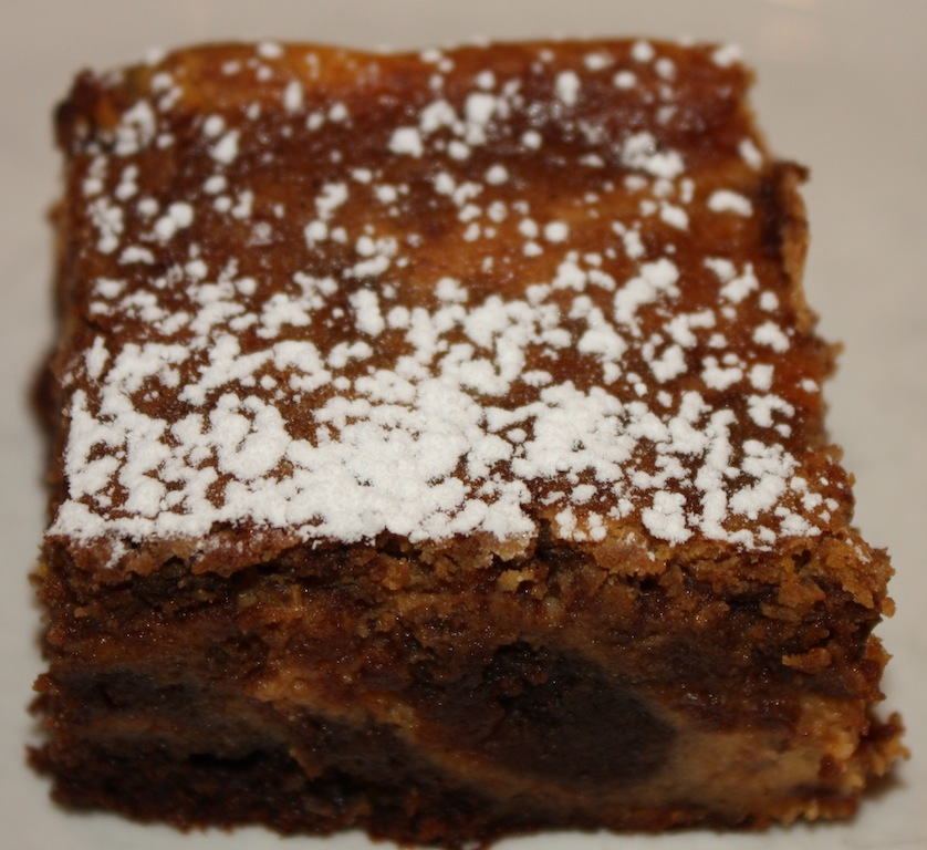 Pumpkin Chocolate Brownies have a chocolate brownie base that is topped with a pumpkin/cinnamon/ginger/cream cheese layer on top. Perfect for Thanksgiving!