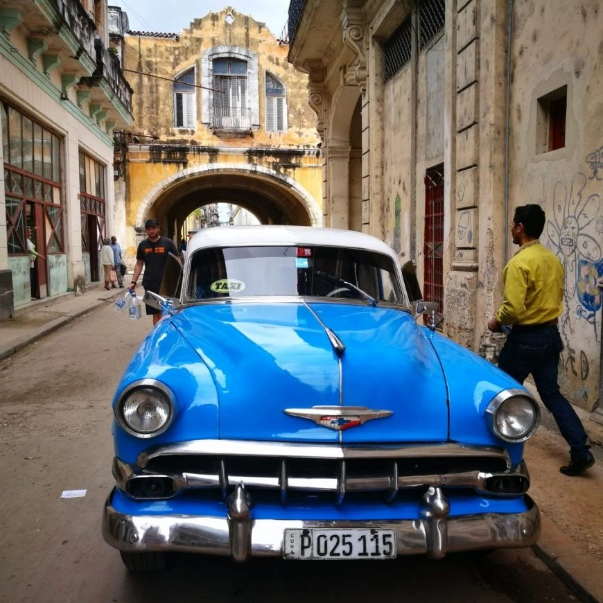 A classic old car parked in crumbling streets of La Habana - 4 Days In Havana Vieja