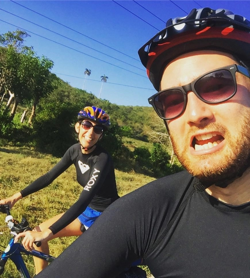 Destination Addict - Pushing through the cycling pain together on the road from El Fraile to Mantanzas, Cuba