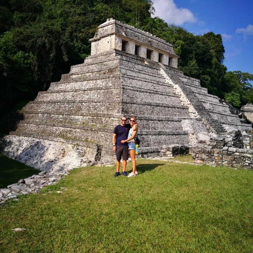 Looking tiny next to the huge ruins of Palenque, Mexico