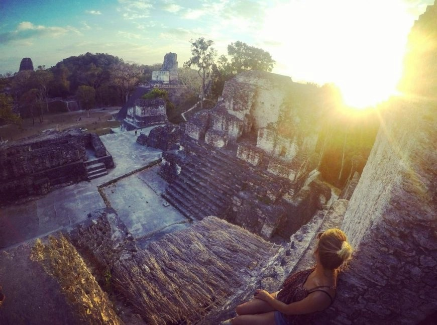 Destination Addict - Taking the sunset in at the ruins of Tikal, Guatemala