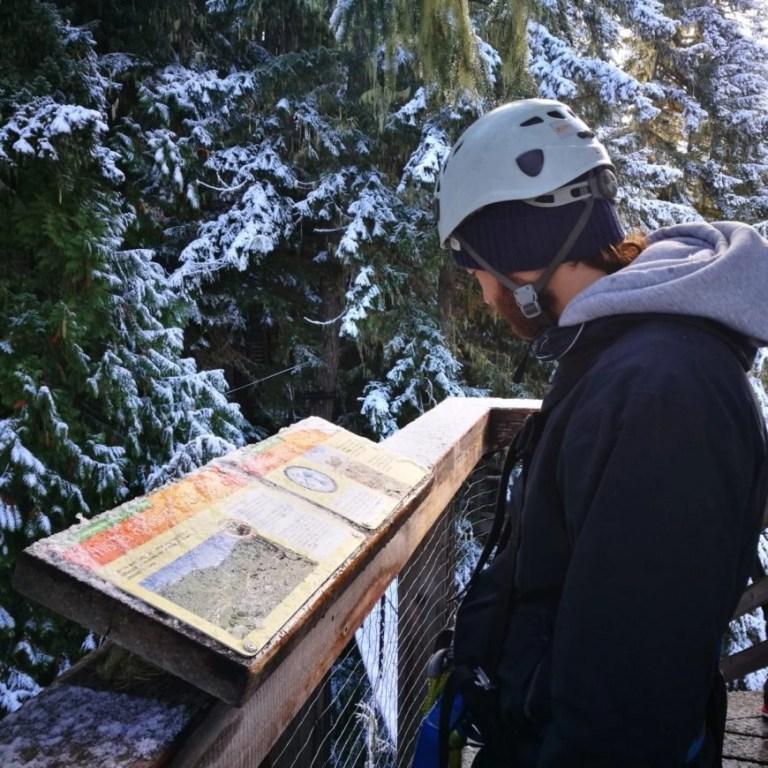 Reading all about the environment on our Ziptrek Ecotours Eagle Tour, Whistler, British Columbia, Canada