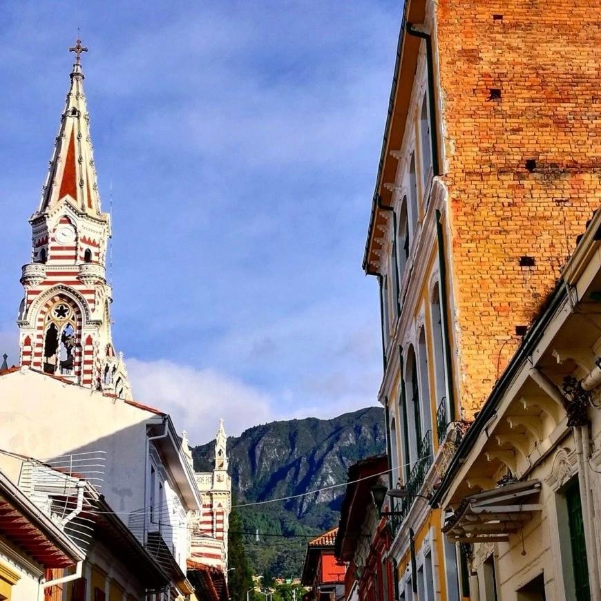 Destination Addict - Iglesia Nuestra Senor del Carmen complete with mountain backdrop, Bogota, Colombia