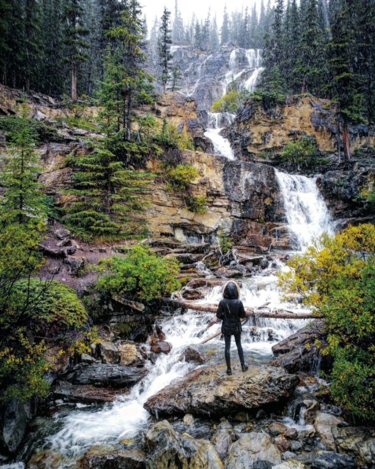 Destination Addict - Admiring one of the many waterfalls you pass on the Icefields Parkway, Alberta, Canada