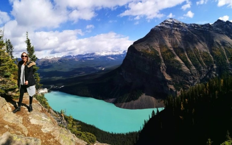 Destination Addict - At the Top of Big Beehive with view of Lake Louise, Alberta, Canada