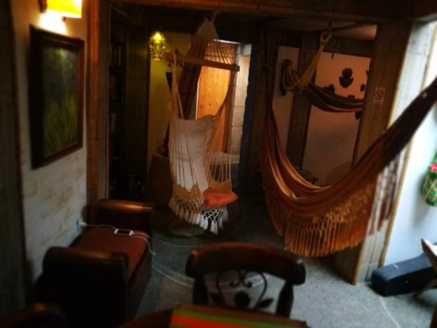 Destination Addict - The cosy lounge & dining area inside of Kasaguadua, Salento, Colombia