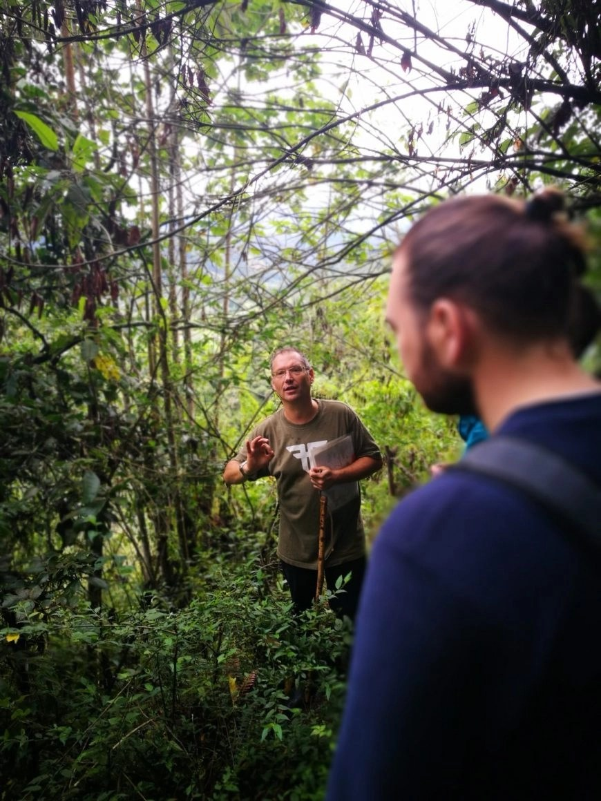 Destination Addict - Carlos taking us on an informative tour of Kasaguadua's grounds, Salento, Colombia