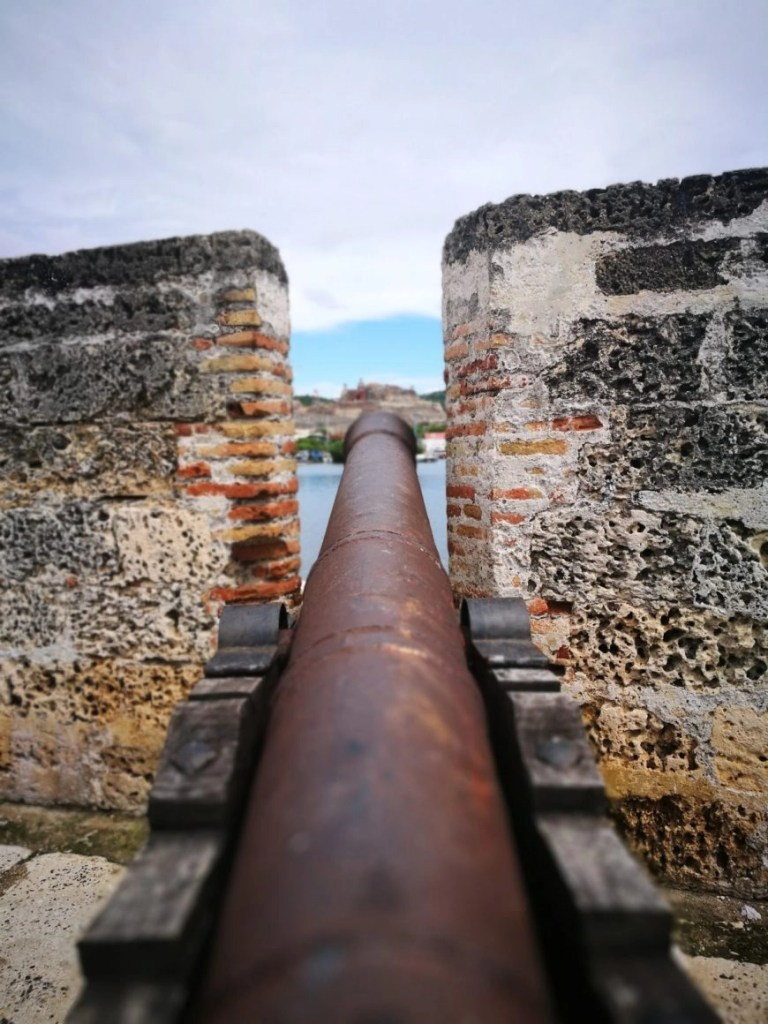 Destination Addict - Looking out from one of the many canons around the city walls, Cartagena, Colombia