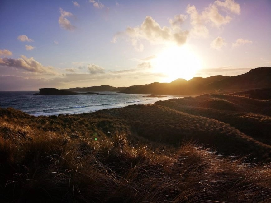 Catching the sunset at Oldshoremore Beach, NC500 – An Epic Itinerary For Scotland's North Coast - Destination Addict
