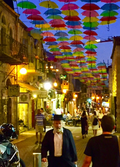 "A bustling city street in Jerusalem's ""Downtown Triangle"""