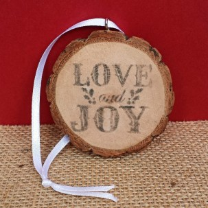 Use Wood Slices, Printables, Eye Hooks, and Ribbon to Create a Festive Ornament