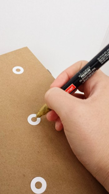 Dress Up Wrapping Paper with Hole Reinforcers and Gold Markers
