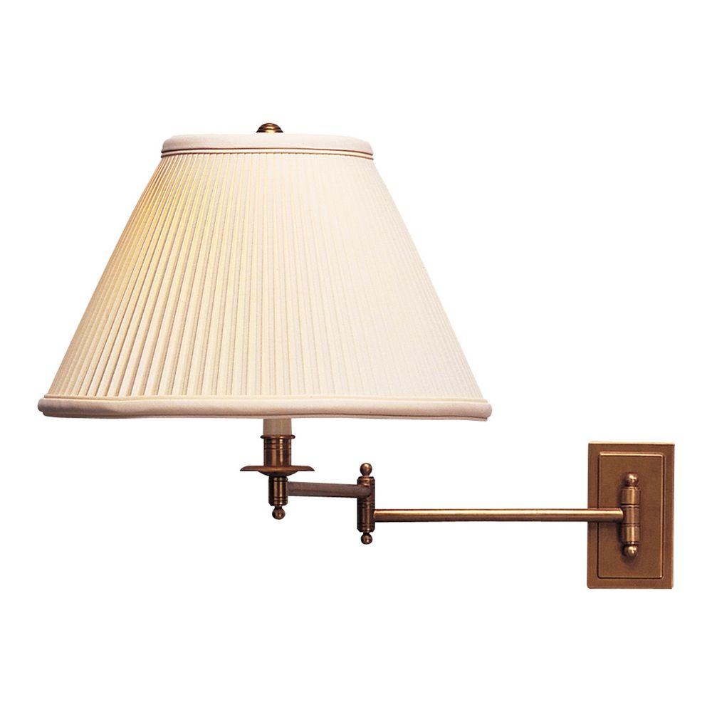 robert abbey kinetic brass swing arm lamp at destination lighting