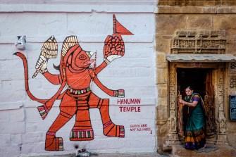 Woman leaves the Hanuman temple