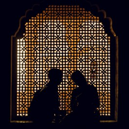 Silhouette of couple in front of window